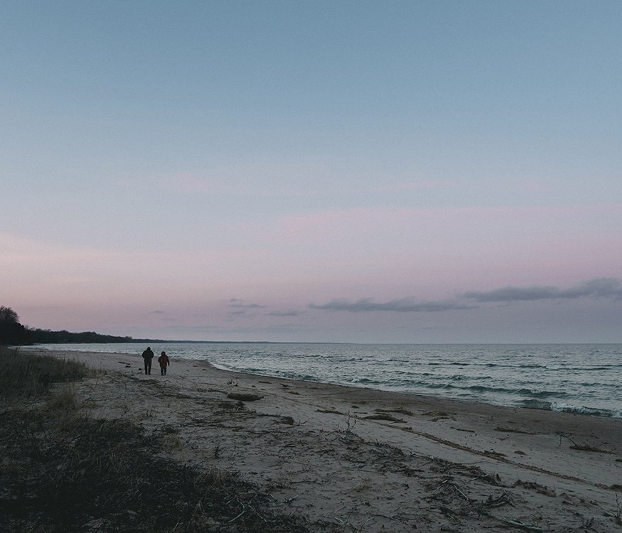 Couple Walking On the Beach Experiencing Grief