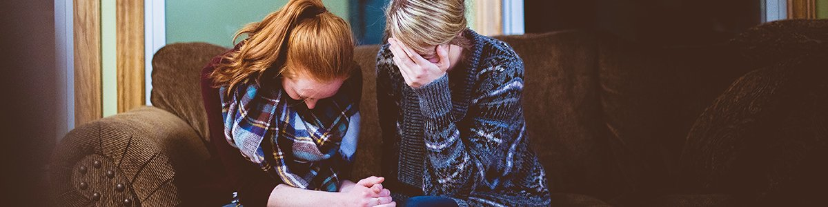 Women Consoling Each Other from Grief