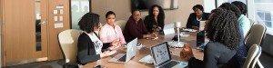 women in an office boardroom