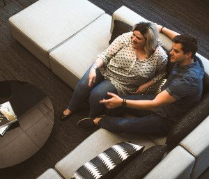 Couple sitting and communicating on couch together